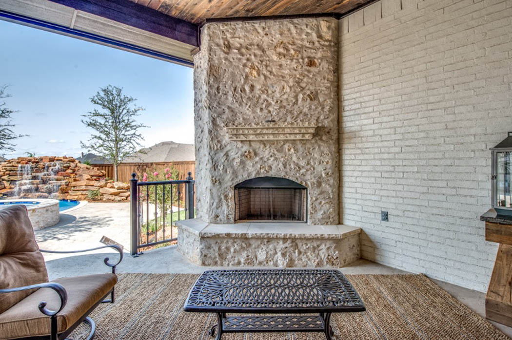 Nice outdoor patio with fireplace in custom home.