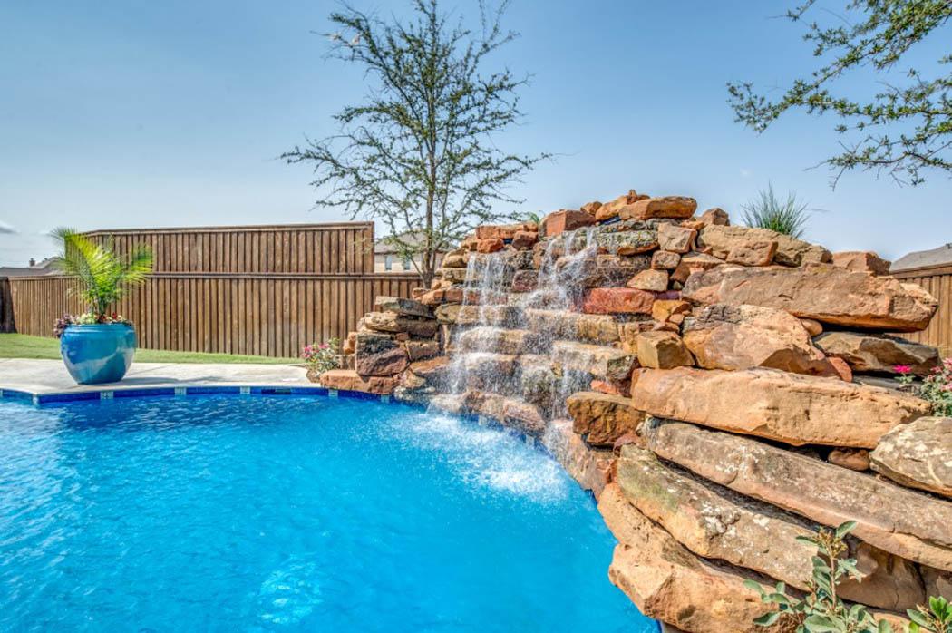 Custom rock treatment in pool of home by Sharkey Custom Homes.