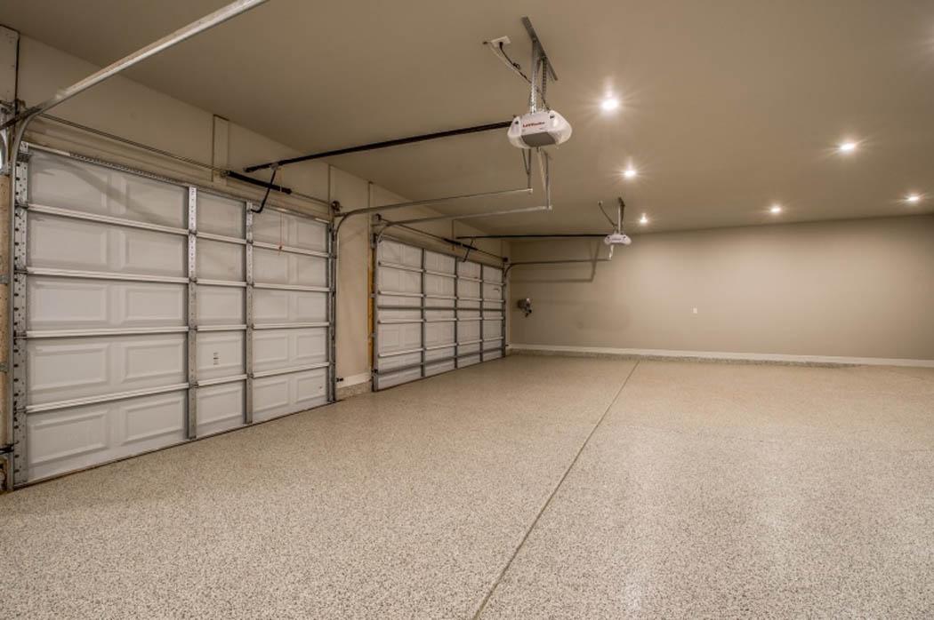 Three car garage with custom floor treatment in house by Sharkey Custom Homes in Lubbock.