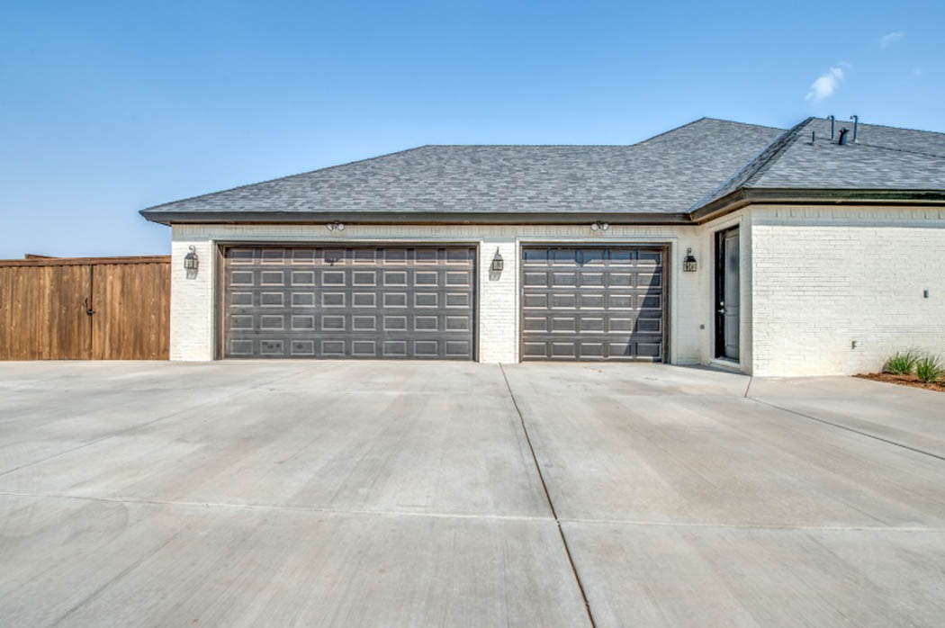 Exterior View of Custom Home Garage in Lubbock, Texas.