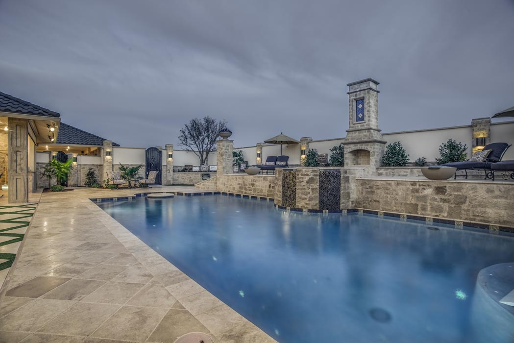 Evening view of pool of custom home in Lubbock.