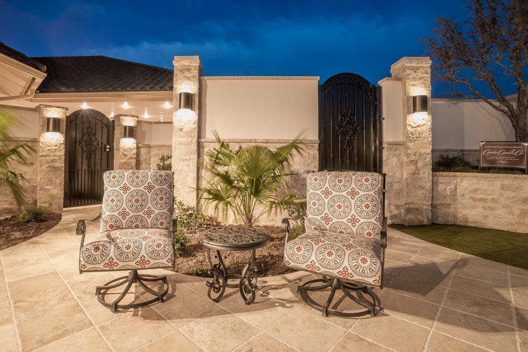 Evening view of cozy seating area in custom patio of beautiful home in Lubbock.