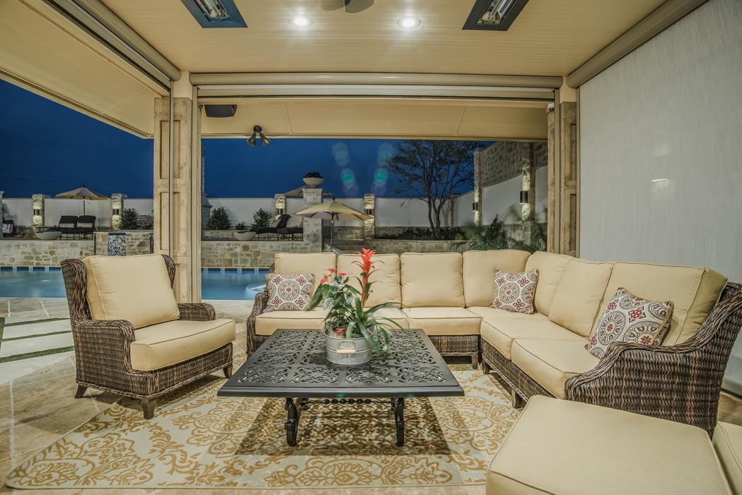 Eveining view of custom outdoor dining space, perfect for entertaining, in custom home.