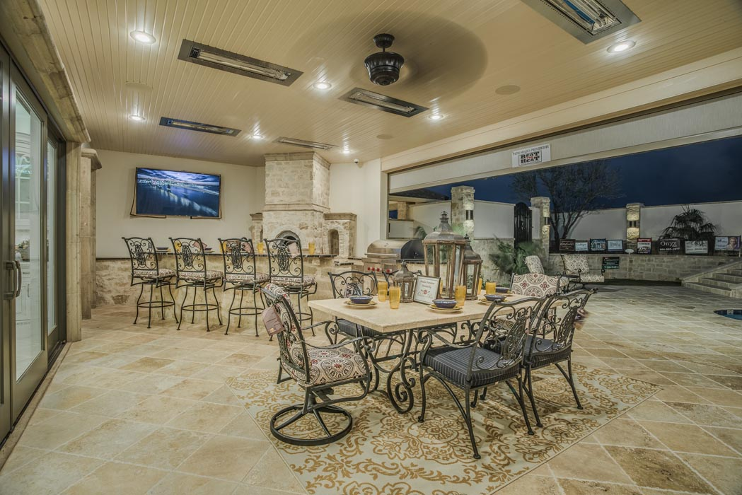Evening view of beautiful outdoor dining area in custom home built by Sharkey Custom Homes in the Lubbock area.