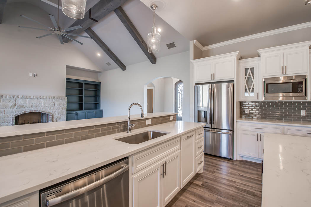 Spacious kitchen with island in Lubbock area home.