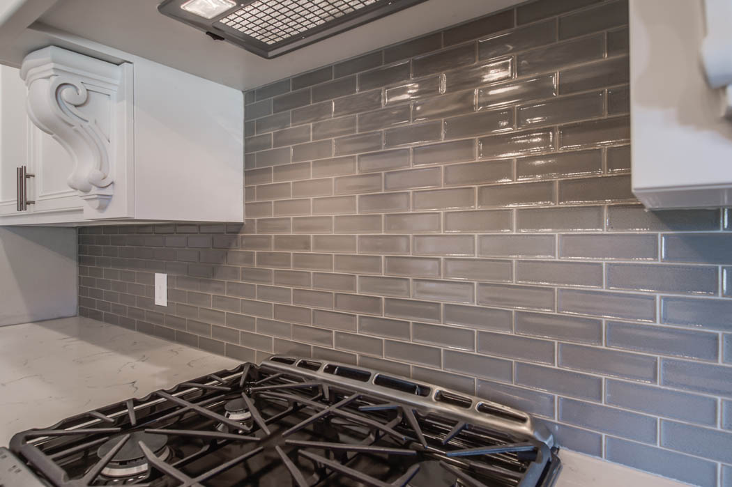 Detail of stove area in custom home kitchen.