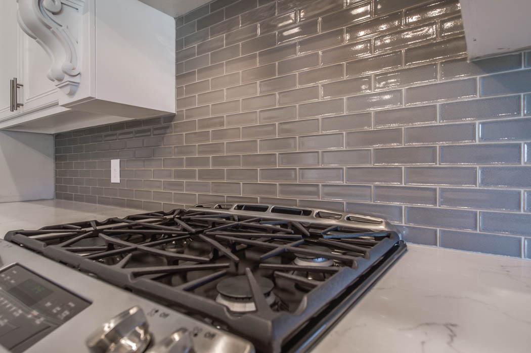Detail of kitchen tile in custom Lubbock home.