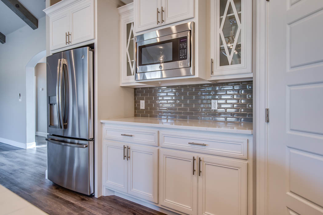 View of spacious kitchen in custom Lubbock house by Sharkey Custom Homes.