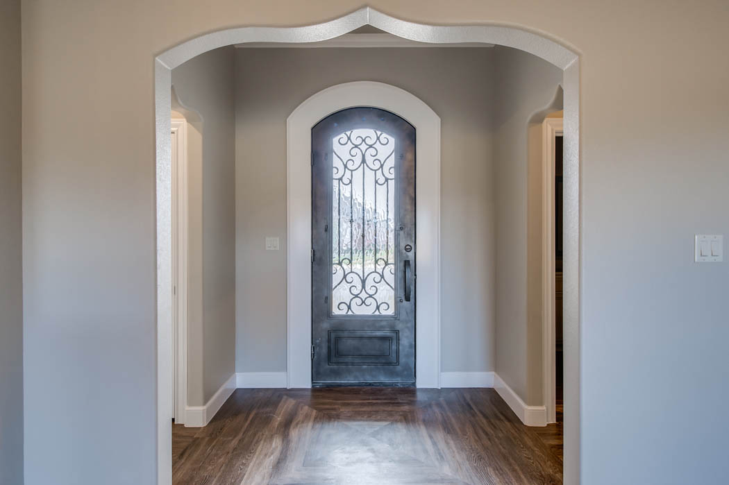 Beautiful entry in custom home by Sharkey Custom Homes.