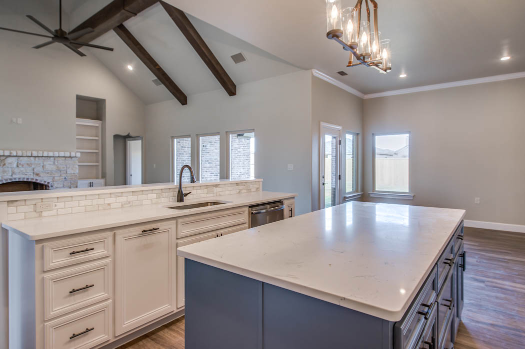 Custom home kitchen with countertop bar area in Lubbock.