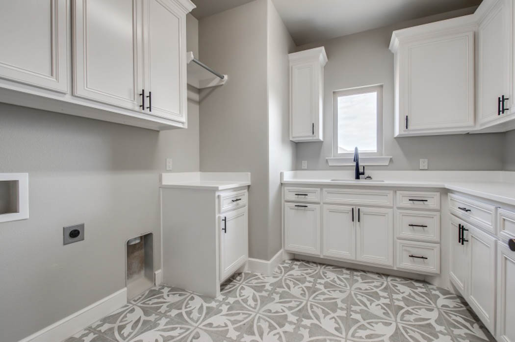 Laundry area in beautiful home by Sharkey Custom Homes.