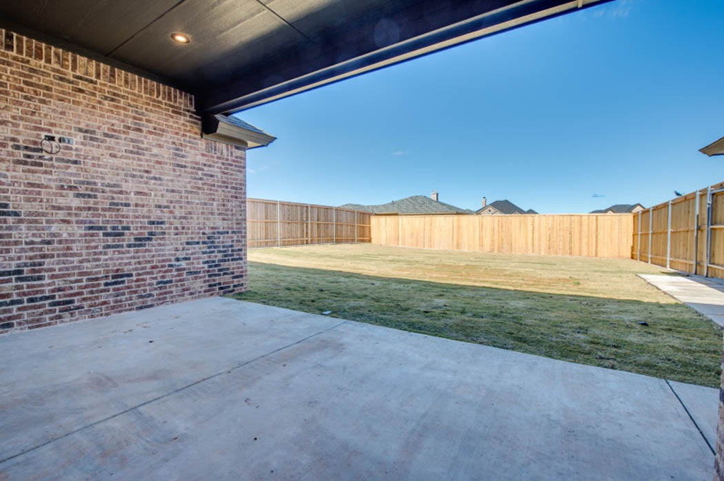 Spacious patio in Lubbock area custom home.