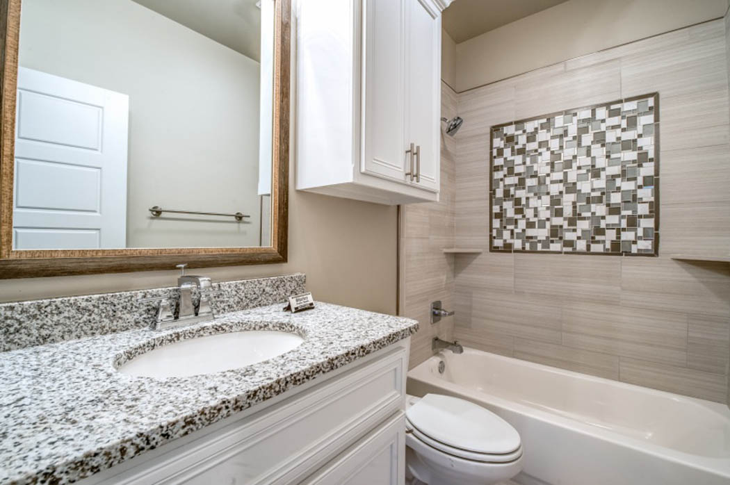 Detail of shower-bath in custom Lubbock home.