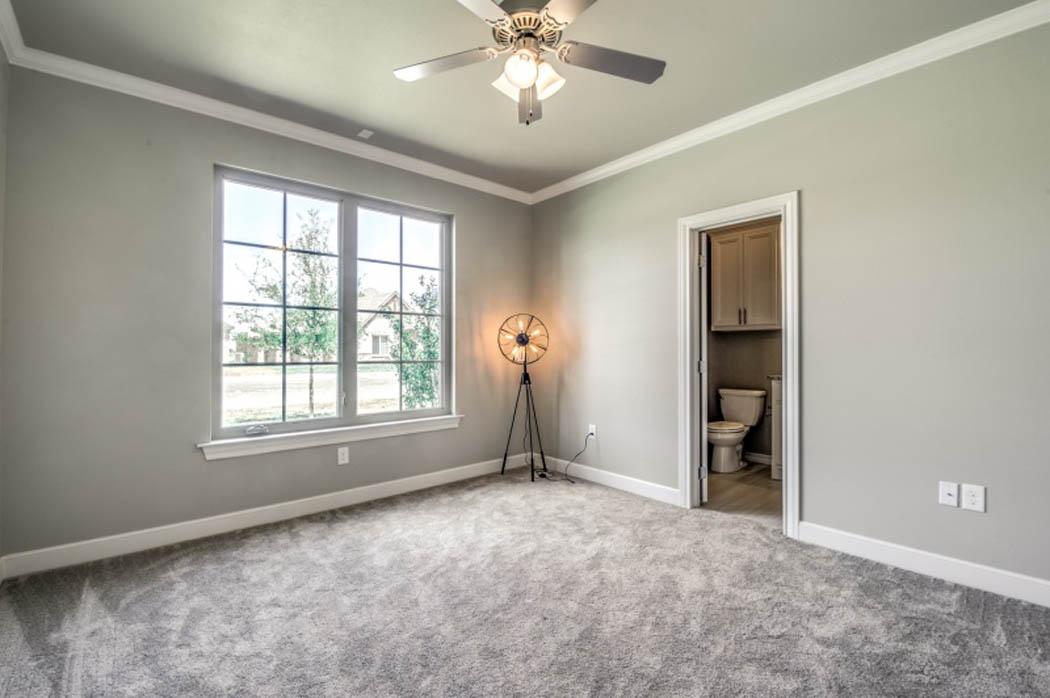 Spacious bedroom in Lubbock area custom home.