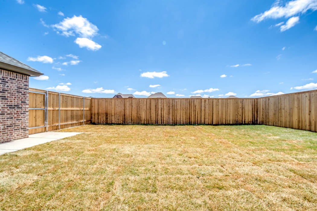 Large backyard in custom Lubbock home.