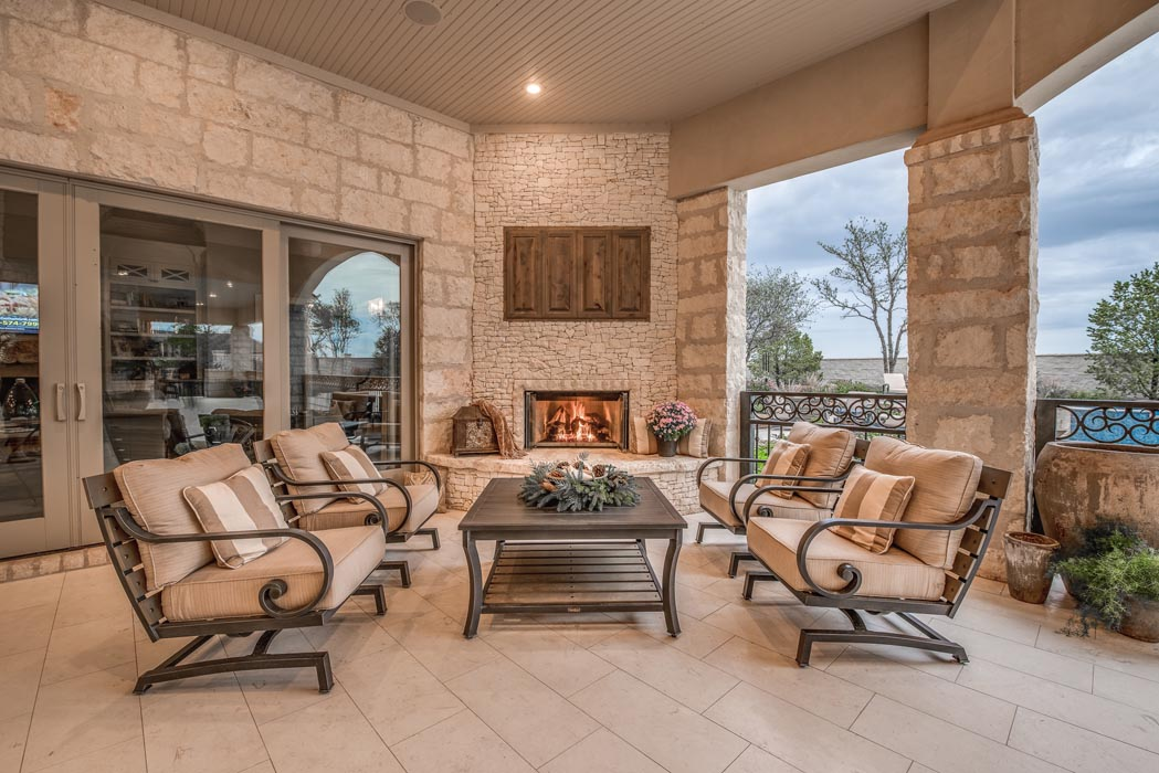Cozy sitting area in outdoor patio space of custom home.