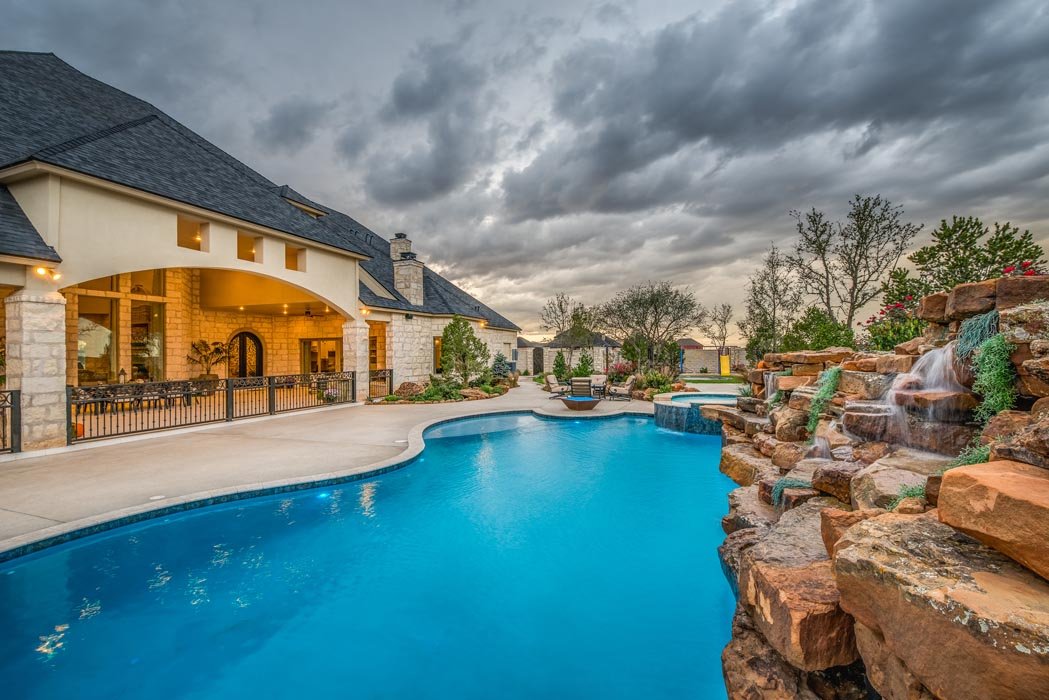 Alternate view of pool and exterior of beautiful new home built by Sharkey Custom Homes in Lubbock, Texas.