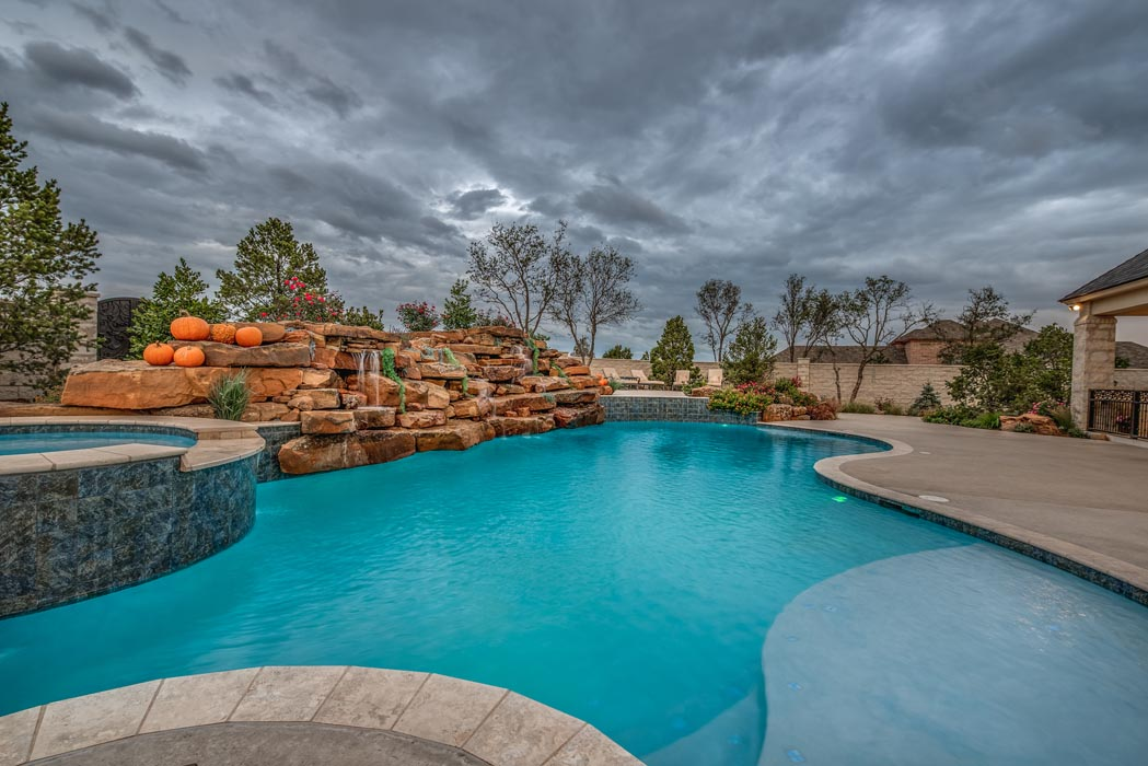 Amazing swimming pool in beautiful outdoor space of custom home in Lubbock.