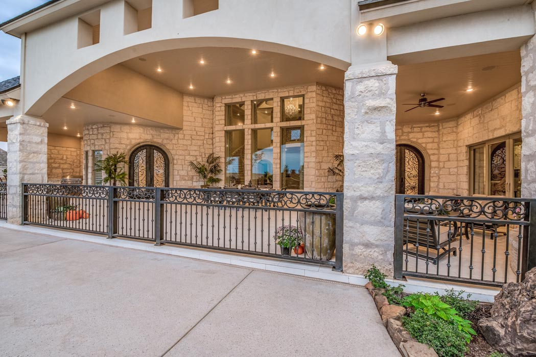 Beautiful arched stonework and railing of outdoor entertaining area.