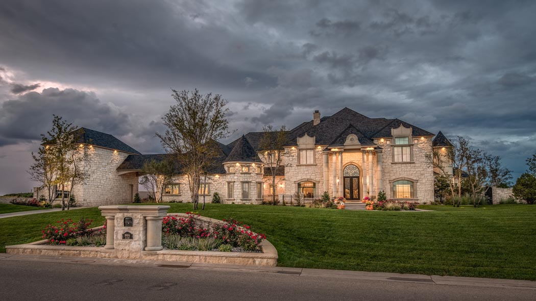 Exterior evening view of beautiful custom home in Lubbock, Texas.