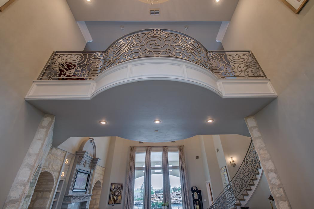 Balcony with amazing metal scrollwork in custom home in Lubbock, Texas.