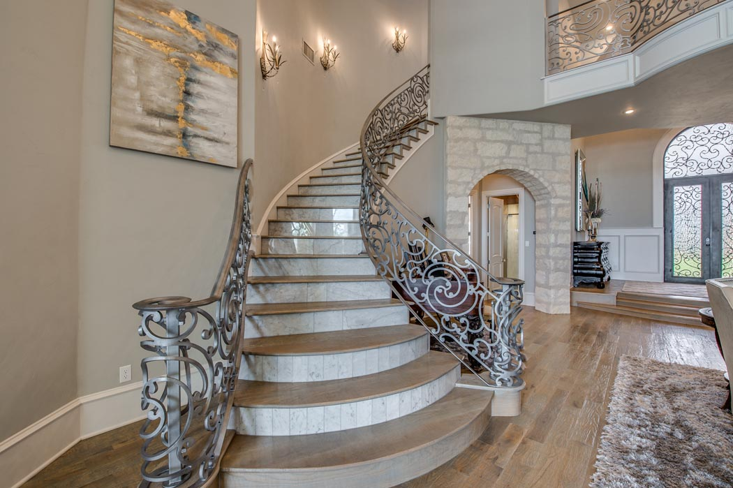 Stunning, flowing staircase of custom home in Lubbock, Texas.