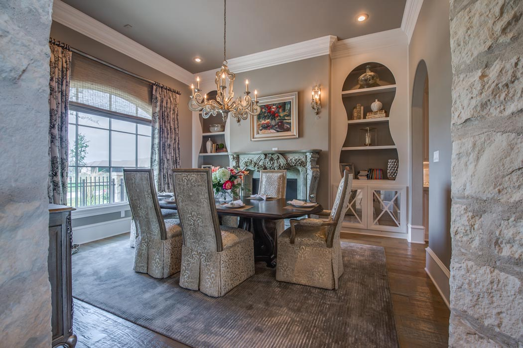 Dining area of custom home featuring Austin stone.