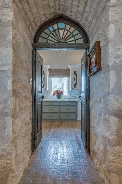 Hallway to Butler's Pantry, featuring specialized door and wall treatments.