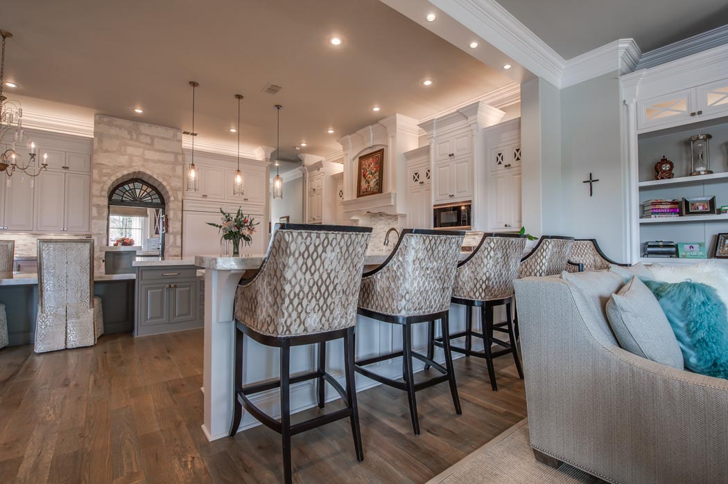 Stools at kitchen island in custom home, built in Lubbock, Texas.