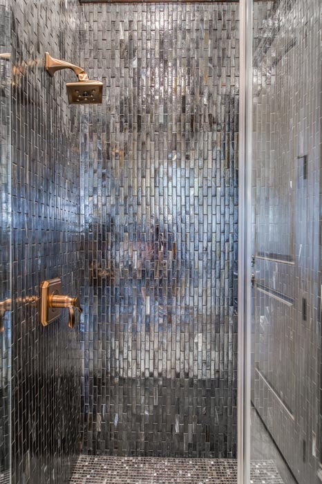 Detail of shower in amazing bath in custom home.
