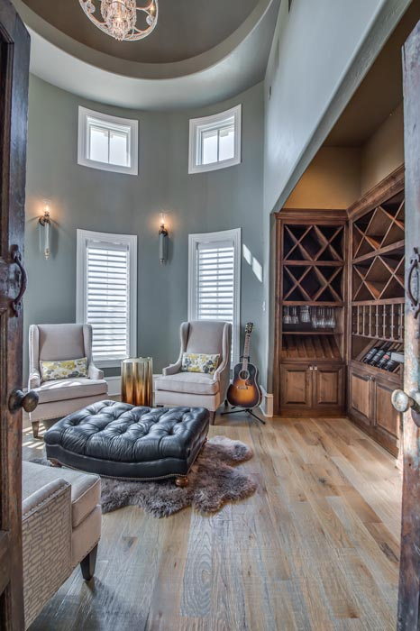 Beautiful two-story interior living or den space in home built by Sharkey Custom Homes in the Lubbock area.