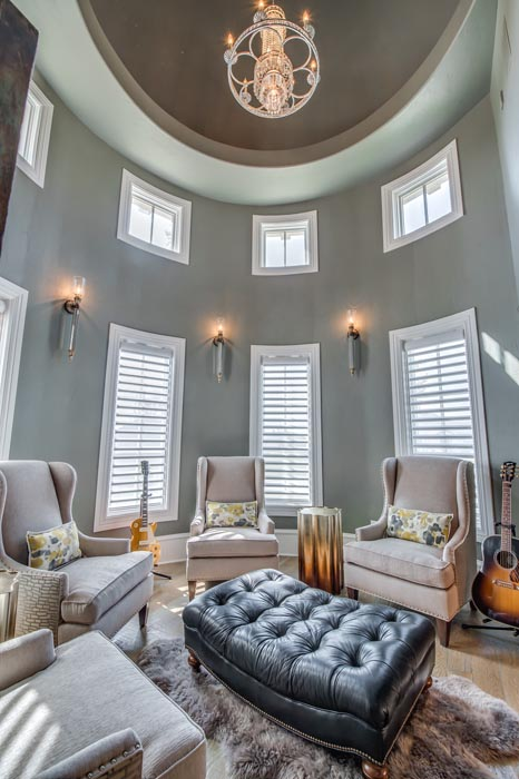 Round living or study area in custom home, which is located inside the home's turret.