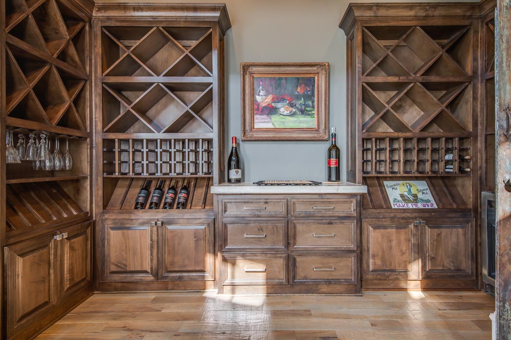 Detail of special woodwork in amazing 2-story living area in custom home.