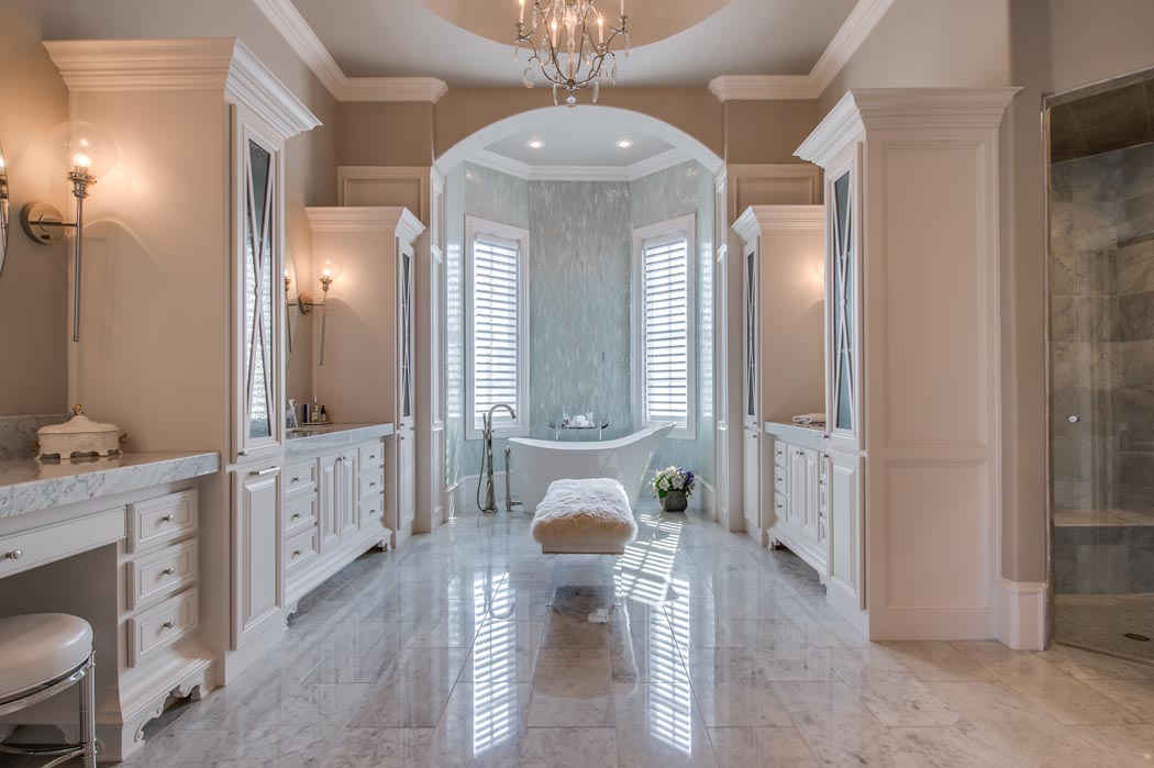 Incredible master bath in soothing colors with custom tub, in custom home in Lubbock, Texas.