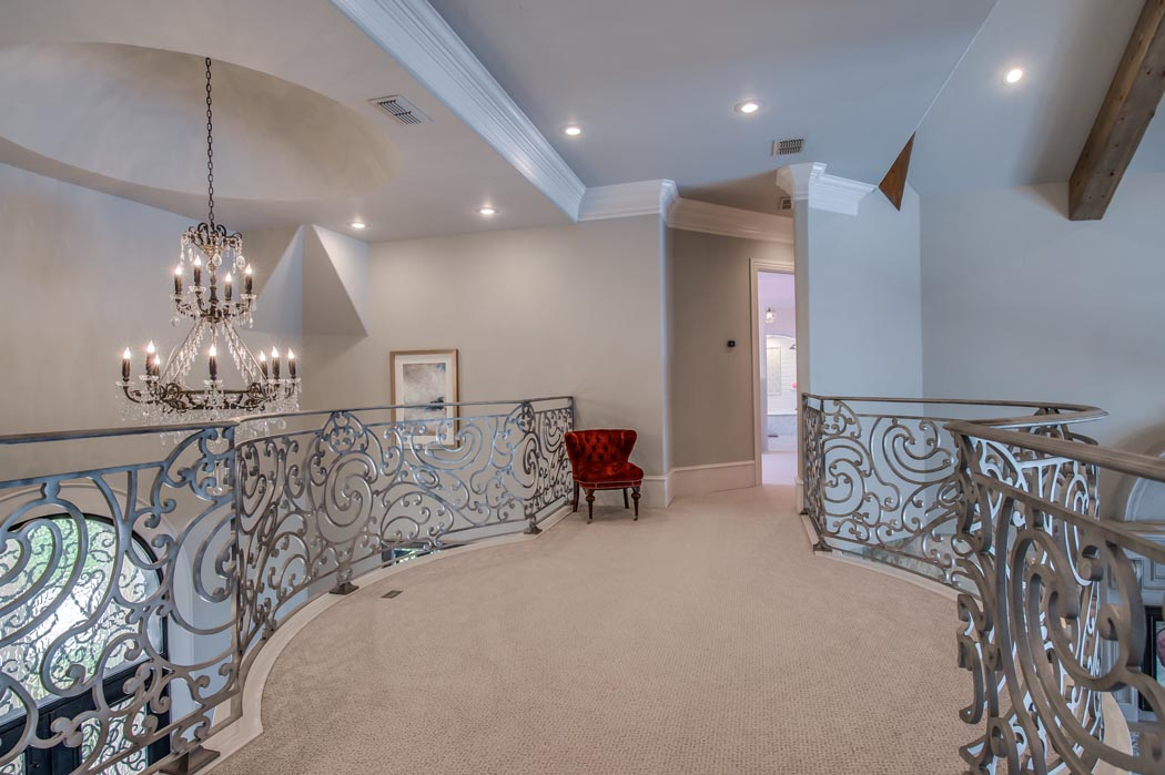 Beautiful 2nd floor landing in custom home built in Lubbock by Sharkey Custom Homes.
