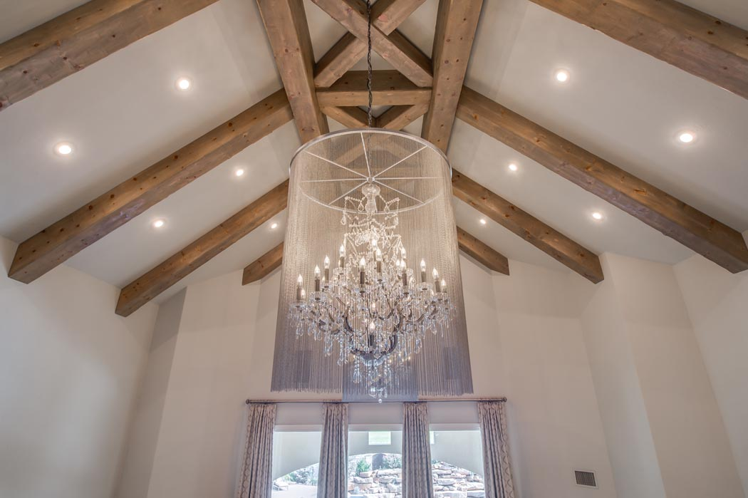 View of cathedral ceiling with wood beams in Lubbock custom home.