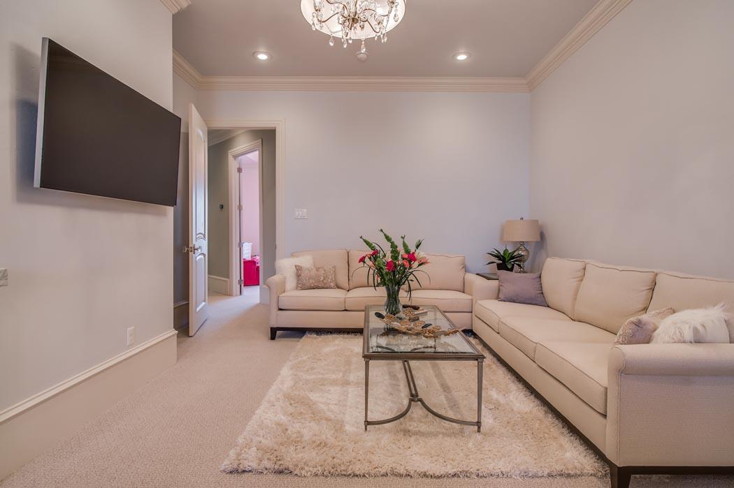 Alternate view of den/living area in Lubbock custom home.