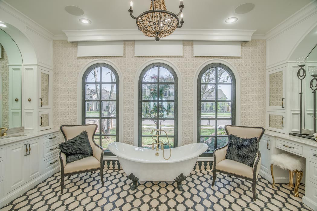 Master bath with guest chairs in custom home.