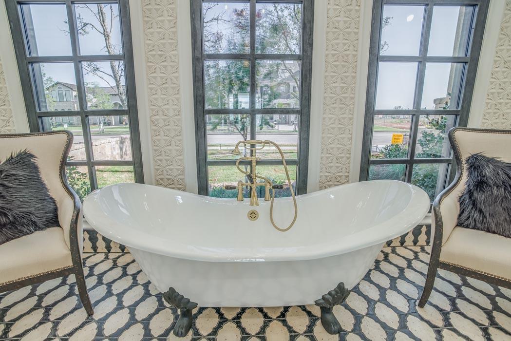 Elegant tub in spacious master bath of custom home.
