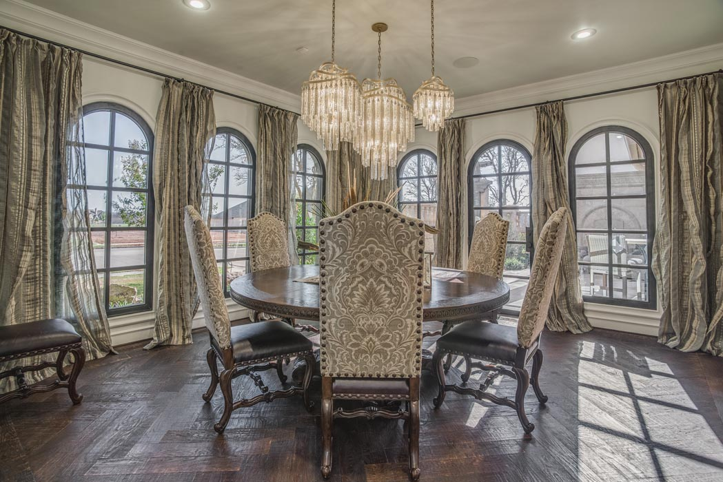 Spacious dining room with arched windows in custom home.