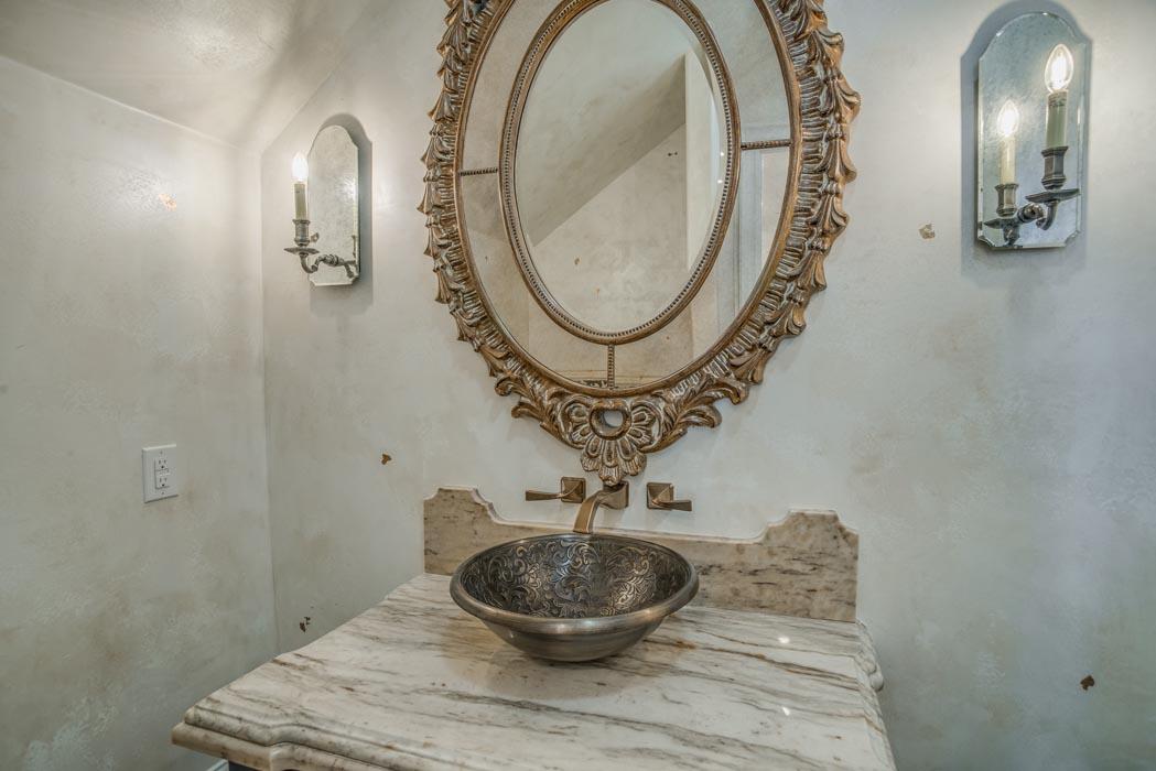 Vanity in guest bath of custom home, featuring bowl sink.