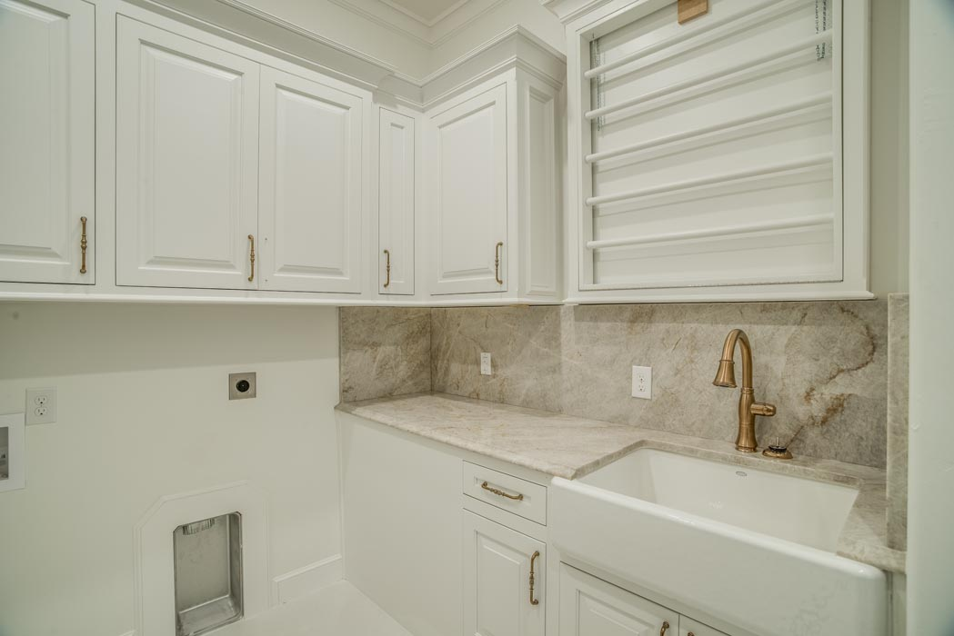 View of spacious laundry room in custom home.