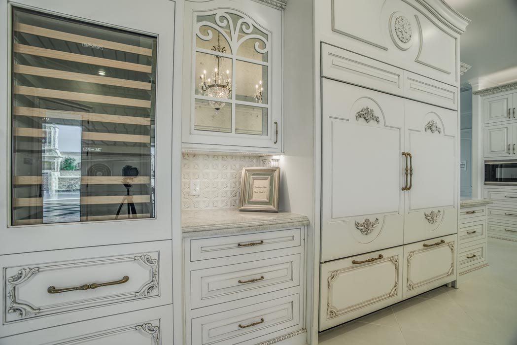Kitchen in custom home, with special styling and woodwork.