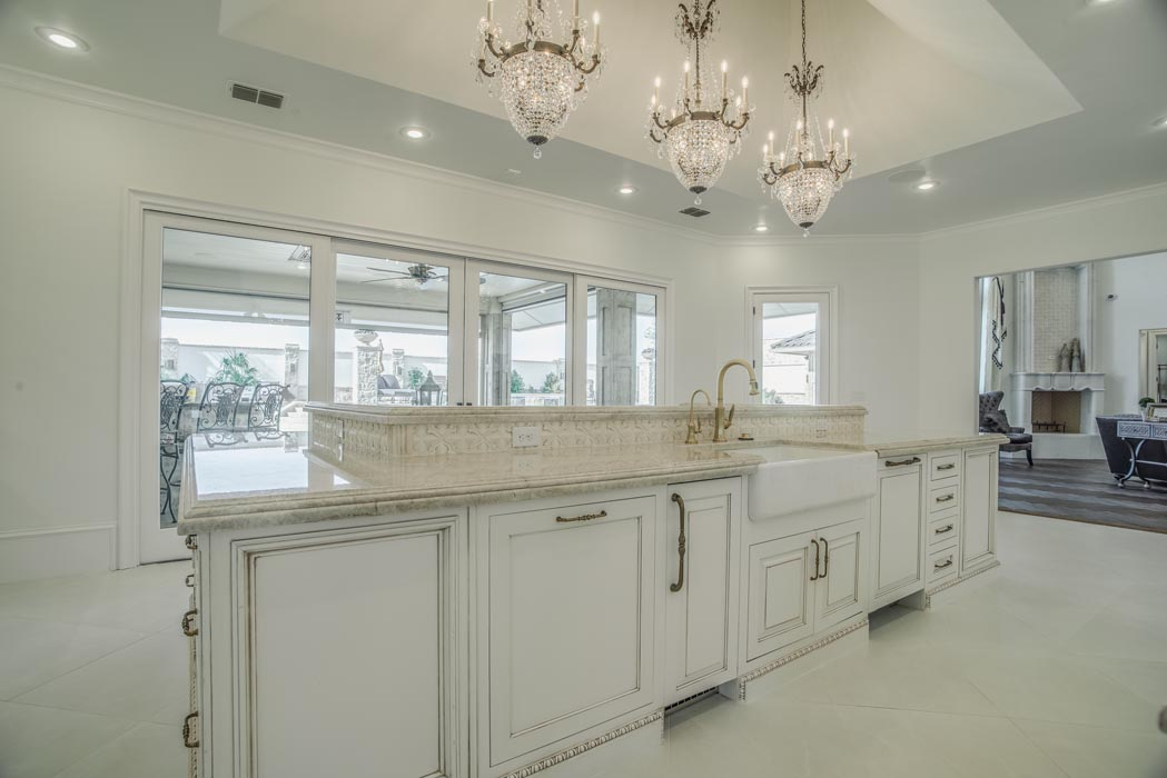 Spacious kitchen in custom home, with island.