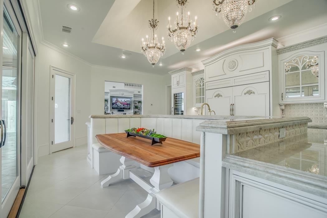 Breakfast nook with wood table in custom kitchen.