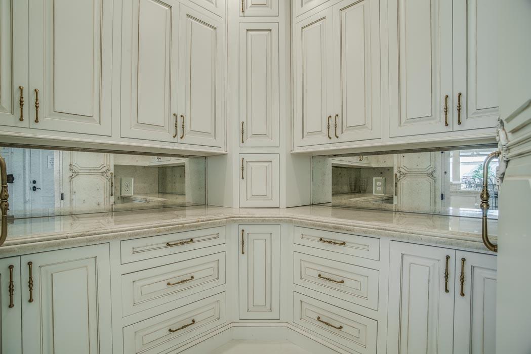 Spacious kitchen work area with mirrored backsplash.