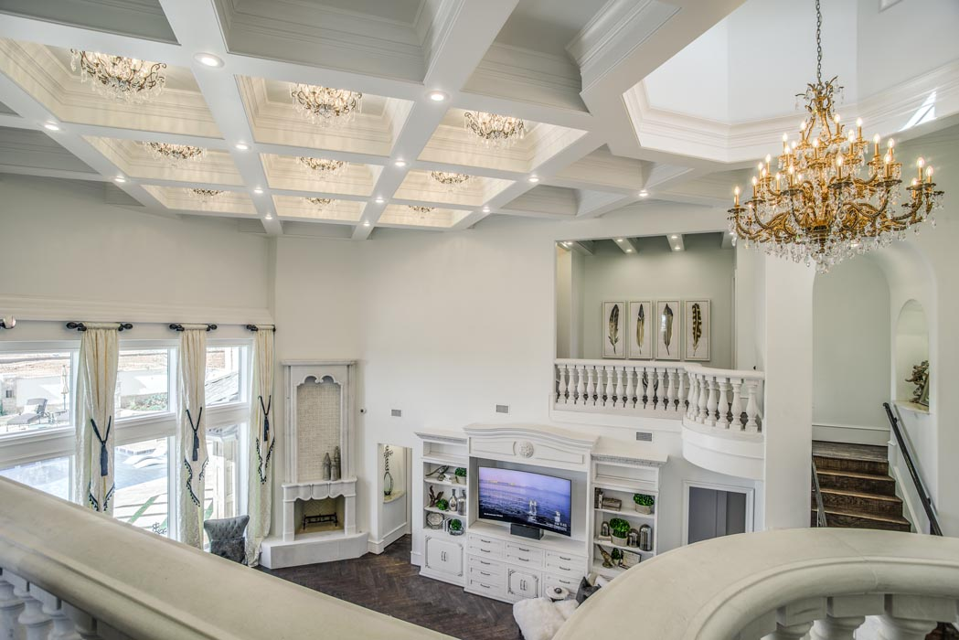 Second story view of living area in elegant custom home.