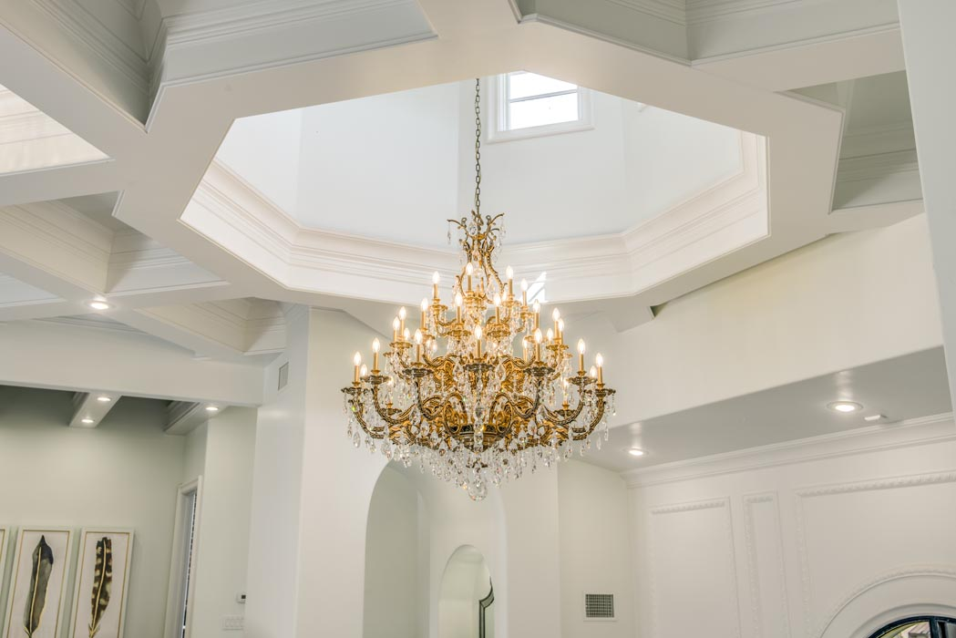 Chandelier in living area and custom ceiling of home in Lubbock.