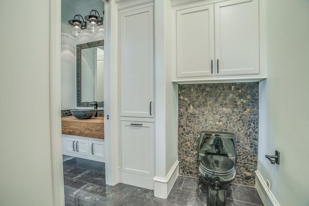 Water closet area in bath of custom home in Lubbock.