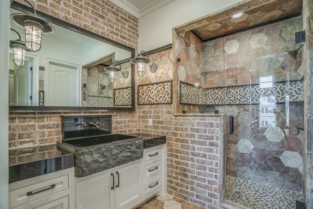 Bath in custom home with specialty vanity and sink features.